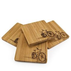 Let It Ride Coasters Set of 4, $20, crafted from sustainably harvested bamboo with hand-burned bicycle motif