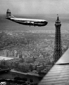 Avion volant au dessus de Paris en 1949. please dont hit that, tourist sightseeing plane gets a ittle to close to the eiffel tower for comfort , alittle but arghhh rather than boooo, but scarey just the same