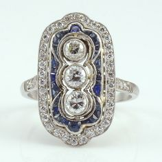 Vintage platinum Art Deco ring with center diamonds and sapphires, circa 1920…