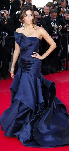 "Eva Longoria arrives for the ""Carol"" premier wearing a sapphire blue taffeta ruffled fishtail gown, complete with single bardot sleeve and embellishment by Atelier Versace. #Cannes #2015"