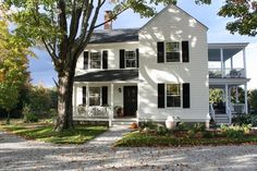 Two Story New-Old Farmhouse with a Wrap-Around Porch