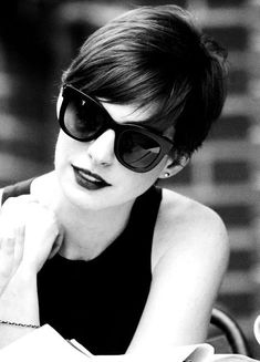 Anne Hathaway.  Love this haircut.  Love the glasses.  Love everything.