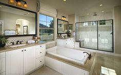 Upstairs, an expansive master suite offers his-and-her closets and resort inspired bath with separate shower and soaking tub. - Residence 3 at Hanover Village at the Park in Camarillo, CA