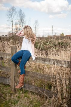 Class of 2014 Feild, chic, county, senior photo, pose,cowboy boots, swing shirt, victoria secret curls, fence Photos by B. Jones Photography