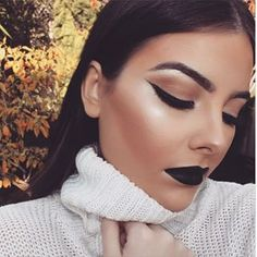 Nothing says fall like a cozy sweater and jet black lipstick. | 23 People Who Are Totally Rocking Black Lipstick