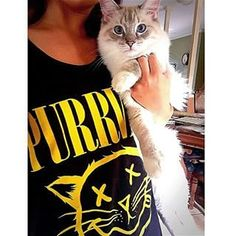 Our friend finley_theragdoll posing next to our 'PURRVANA' tank top! #animalhearted #animalheartedapparel