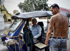 I was Chopin' it up with this Tuk Tuk driver and he started telling me about his tattoos and their meaning.. next thing you know his shirt is off to show me his back piece.
