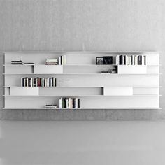 From Resource Furniture- a modular wall system called Goldenice. Artful and functional.