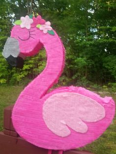 FLAMINGO PINATA. Measures 24 inches tall by 18 inches wide, 4 inches deep, without adding legs length. If you are looking for a different design or character, please feel free to contact me, I will be happy to create a custom order right for you