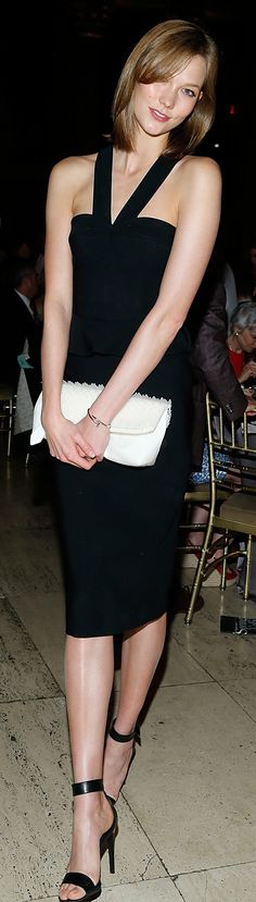 American model Karlie Kloss wearing Burberry and carrying The Petal bag at The New Museum Annual Spring Gala in New York