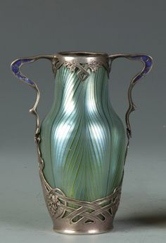 An Art Nouveau Loetz glass silver mounted vase.