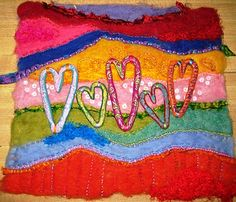 Mixed media wool roving polymer clay art quilt made by Cindy Dubbers at Crimson Heart Studios