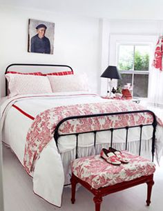 Red and white toile de jouy in the bedroom.