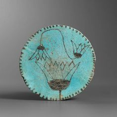 Egyptian faience plate with lotuses. End of New Kingdom –Third Intermediate Period (late 2nd–early 1st millennium B.C.).