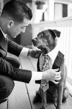 This is such a remarkable picture... the bond between the man & his dog can be felt through the photo.