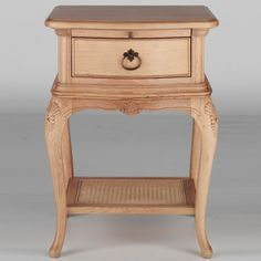 The oak 'Chateau' range draws inspiration from the sophisticated styling of 18th century French furniture. It features ornate carved detailing, soft curved lines and a lacquered finish which gives a warm and natural look. This bedside cabinet also features a single drawer with ring handle and an additional sliding tray.