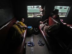 Passengers rest inside a train while waiting for the electricity to be restored at a railway station in Kolkata Tuesday. Grids supplying electricity to half of India's 1.2 billion people collapsed Tuesday, trapping coal miners, stranding train travellers and plunging hospitals into darkness in the second major blackout in as many days.