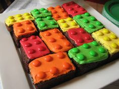 Brownie Legos with frosting and m instead of cake. This site also has cute fruit/veggie platter ideas and pin the head on the lego guy on kids easel.