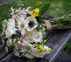 Wildflower bouquet in whites with touches of yellow....i really love this one