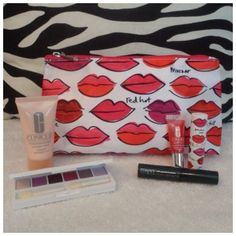 """Hot Lips 6Pc Clinique Cosmetic Gift Bag Sat NEW Clinique 6Pc Travel Size Gift Set: Red Hot Silky Feel/Fully Lined Lips Bag 5""""x9.5""""x2.5"""" 02 Raspberry Super Balm Moisturizing Gloss  Matte Plum Full Size Lip stick Moisture Surge Overnight Mask 1fl. Oz 01 Black High Impact Mascara  Limited Edition All About Shadow Palette #24 Royal Couple#32 Rock Violet Ca Raspberry Beret Limited Edition Pearly Pink Limited Edition #06 Pink Chocolate. This is a Fabulous Set! All pieces are NEW. Price is FIRM…"""