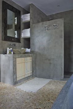 Cement walls, pebble floor, river stone sink by True Ibiza