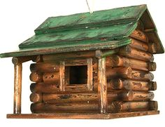 You may not be able to move into a beautiful log cabin in the country yet, but you can look at a rustic log cabin in your backyards that is for the birds!  All wood construction,   This great looking rustic wood log cabin style bird house with green roof is 7.5 x 9 inch and  7.5 inch high and sure to please the birds in your backyard.   Heavy-duty wire rope for hanging,   Removable plastic  cleanout plug on bottom.               Perfect lake home, cottage owner gift as a thank you for…