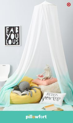You can always count on a canopy to turn an ordinary space into cozy kid zone. Hung over comfy beanbag chairs, this canopy from Pillowfort's Discovery Den collection lets little ones cuddle up with the softest throws, pillows and favorite animal friends for some chill reading or quiet time.