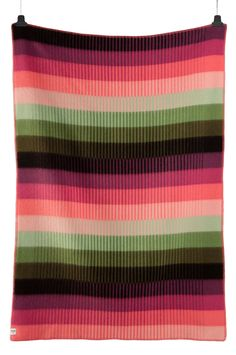 Åsmund blankets and pillows has clean geometric shapes that are softened by rich palettes. The series is inspired by textile and wool tapestries, interpreted in a modern way. The series comes in three color palettes - pink / green, yellow / purple and red / turquoise. Design by Kristine Five Melvær Size: 130x200cm (approx 51 inches by 78 inches) Material: 100% Norwegian Lambswool From Norway Matching Asmund Gradient Pillow Click Here