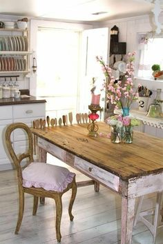 Love the distressed pink farmhouse table