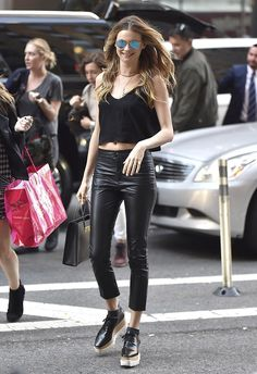Behati Prinsloo opted for an edgy all-black look that included a loose crop top, leather pants, and platform creepers.