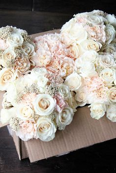 Blush bouquets of roses, carnations and rice flower: