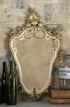 ornate mirror, papered walls ♥