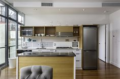Small and ergonomic modern kitchen with wooden cabinets and a white countertop
