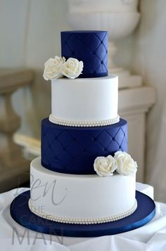 Stunning white and royal blue wedding cake idea