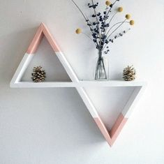 Wooden triangular shelf. This geometric wall shelf is made in the shape of a triangle to show creativity in interior design. Via en.DaWanda.com.