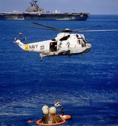 An Apollo 17 astronaut is hoisted aboard the hovering Sikorsky SH-3G Sea King, Bu. No. 149930. USS Ticonderoga stands by. (NASA)