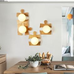 Mix and match jigsaw puzzles to create your own unique set of lights. Perfect for children's rooms! Room Lights, Wall Lights, Cup Mat, Brass Handles, Unique Home Decor, Kitchen Lighting, Pendant Lamp, Floor Lamp, Jigsaw Puzzles