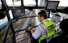 Scott Duncan, an Operations Manager at the new CSX Central Florida Intermodal Logistics Center, operates one of the cranes that will move ca...