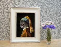Tabby Cat dressed as Vermeer Framed Pet Portrait Print  These look really beautiful and are fantastic, unique gifts for Tabby Cat owners and Vermeer fans.