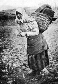 Old Photograph Crofter Carrying Peat while also knitting . North Uist, Scotland