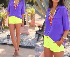 Bubble necklace, purple top, yellow shorts.   Cute summer getaway outfit.