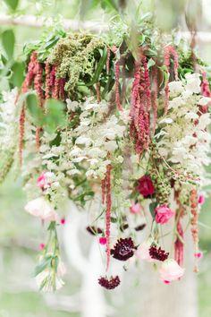 Beautiful hanging flowers: http://www.stylemepretty.com/living/2015/09/24/lakeside-woodland-dinner/   Photography: Katelyn James - http://katelynjames.com/