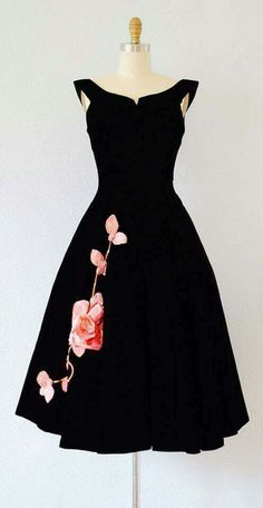 This is truly a very  classy Little Black Dress that really appeals to me so much. I once saw something very similar at a Fashion Show a long time ago and the Rose details were Hand Painted on to the Silk so I wonder if this is the same it's hard to tell from this picture. Beautiful Vintage Dress. Evie Miller.  Fashion Advisor
