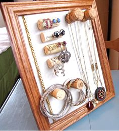 Jewelry organizer with corks.  Like that you could use just a nail or screw driven from back of board, then cover with cork. Cheap and arty.
