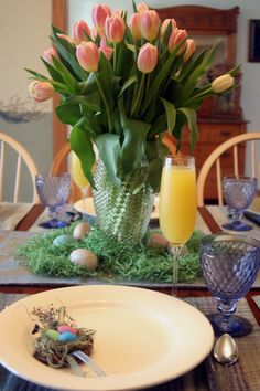 6 Tulip Centerpieces for Your EASTER Table ~ This Easter Brunch arrangement features a pink tulip centerpiece and colorful bird's nests adorning each plate. #diy