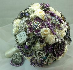 BOUQUET STYLE: cream and purple broach bouquet ivory satin ribbon roses #jewelry_bouquet #nontraditional_bouquet
