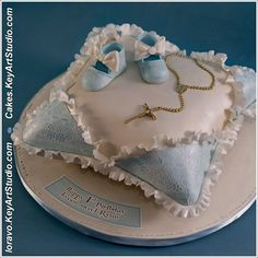 Baptism blue ivory pillow cake with baby booties, cross and ruffles-1