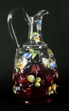 MOSER SHADED CRANBERRY GLASS ENAMELED FLOWER PITCHER. CLEAR TO RICH CRANBERRY GLASS WITH A THUMBPRINT PATTER AND OVERALL DECORATED WITH HAND PAINTED  ENAMEL FLOWERS