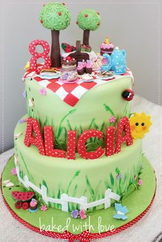 Picnic cake - but less stuff at the top - a tree a blanket and a basket and apple would be enough