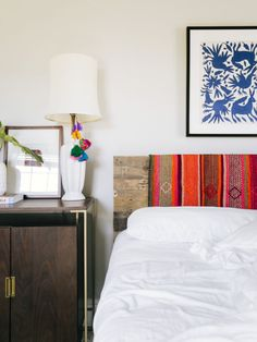 Peruvian frazadas over headboard